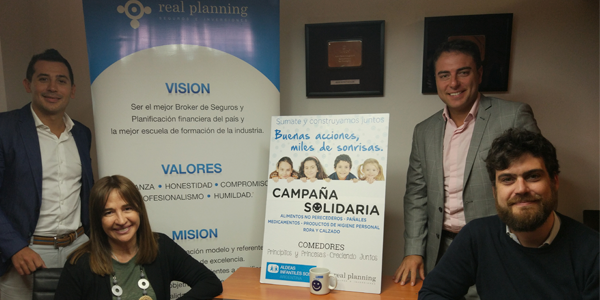 Firma convenio Real Planning
